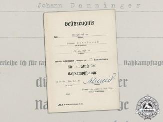 An Award Document for a Bronze Grade Close Combat Clasp to Obergefreiter Johann Danninger
