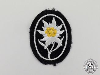 Germany. An Unworn Waffen-SS Gebirgstruppen Edelweiß Sleeve Patch