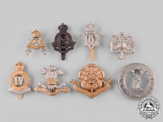 United Kingdom. A Lot of Eight Cap Badges