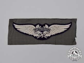 A Mint and Unissued German RLB (Air Raid Protection League) Luftschutz Insignia