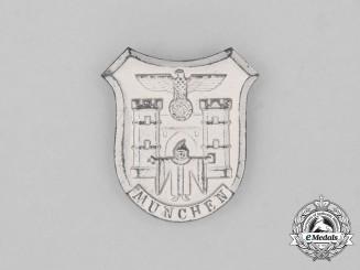 A Third Reich Period German WHW Munich Donation Badge