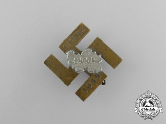 A 1935 Anschluss of the Saar (March 1st) Celebration Badge by Deschler of Munich
