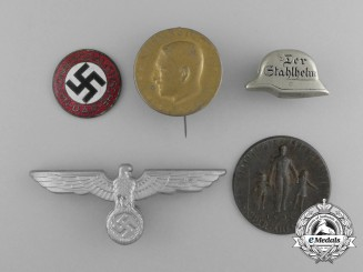 A Grouping of Five Third Reich Period German Badges, Pins and Insignia