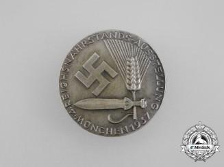 A 1937 4th Reichsnährstands Exhibition Badge by Deschler & Sohn