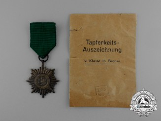 A Bronze Grade Ostvolk Merit Medal with Swords in its Original Packet of Issue by Rudolf Wächtler & Lange