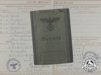 A 1942 Wehrpaß to Karl Hugo; First War Air Observer & Iron Cross 1st Class Recipient