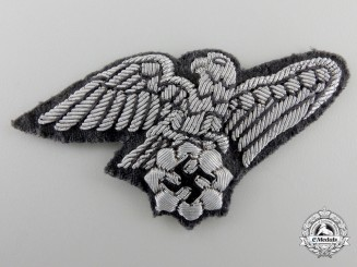 A Tunic Removed German National Air Protection League (Reichsluftschutz) Eagle Insignia