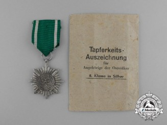 A Silver Grade Eastern People bravery Decoration; 2nd Class in its Original Packet of Issue