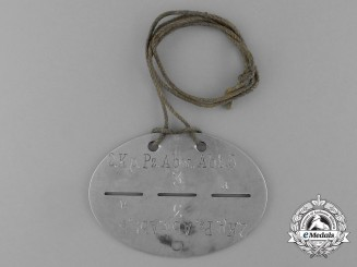 A German 2nd Company Anti-Tank Battalion 53 Identification Tag with its Original String Necklace