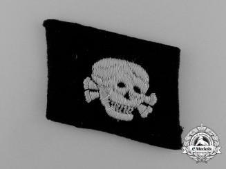 An SS Totenkopf Skull Collar Tab .