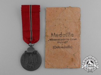 A Eastern Campaign Medal 1941/1942 in its Original Packet of Issue by Steinhauer & Lück of Lüdenscheid