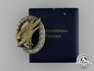 An Early Quality Cased Luftwaffe Paratrooper/Fallschirjäger Badge by C. E. Juncker