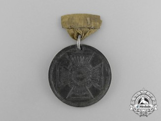 An 1838 Medal for San Sebastian to Staff Assistant Surgeon J.B. Godfrey. British Legion