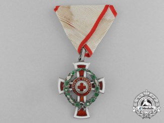 An Austrian Honour Decoration of the Red Cross; 1st Class Cross with War Decoration