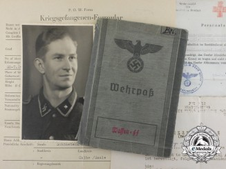 A Wehrpaß & Documents to Ernst Brietz; SS Death's Head Infantry Reserve Battalion III