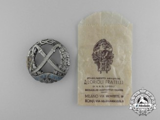 A Second War Italian Russian Front Honour Badge by Lorioli Fratelli in its Original Packet of Issue
