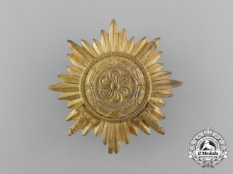 A First Class Ostvolk Decoration; Gold Grade with Swords