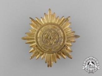 A First Class Ostvolk Decoration; Gold Grade with Swords