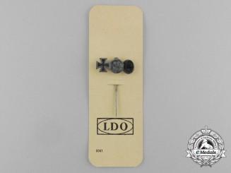 A Second War German Miniature Iron Cross Stickpin Grouping on its LDO Salesman's Board