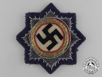 A Kriegsmarine (Navy) Issue German Cross in Gold; Cloth Version by C. E. Juncker