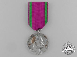 A Saxe-Ernestine House Order Merit Medal; Silver Grade