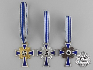 A Grouping of All Three Grades of Mother's Crosses; Gold, Silver, and Bronze Grade