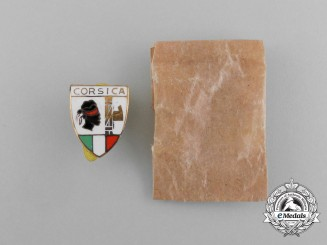 Italy, Corsica. A Fascist Party Badge with Packet of Issue