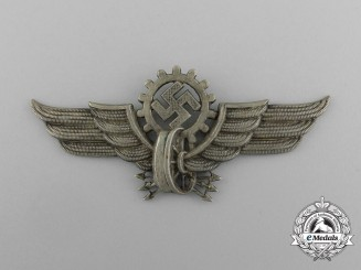 A Visor Cap Badge for Electric Streetcar Operators