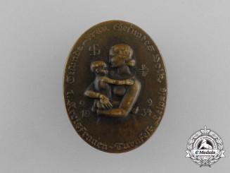 "A 1934 7th Women's District Gymnastics Festival ""Healthy Women - Healthy Volk"" Badge"