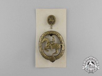 A Mint Second War German Bronze Grade Equestrian Badge and Stick Pin on its Display Board