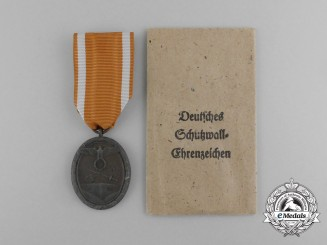 A Second War German West Wall Commemorative Medal with Packet of Issue by Carl Poellath