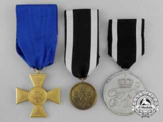 A Grouping of Three First War German Merit and Long Service Commemorative Medals