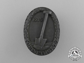 A 1943 HJ Peat-Digging Service Badge