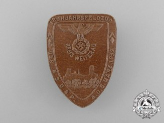 A 1939 NSDAP District Wetterau Springtime Expedition Badge by Kreuter of Glessen