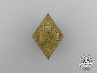 A 1934 HJ/WHW (Winter Relief of the German People) Donation Badge