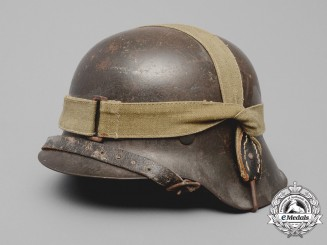 An M42 Wehrmacht Heer (Army) Stahlhelm with a M31 Bread Bag Strap