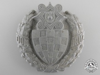 A Croatian Home Guard Gendarmerie Leaders Badge by Knaus