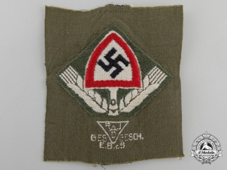 An RAD Green Cloth Cap Insignia