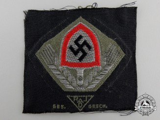 An RAD Black Cloth Cap Insignia