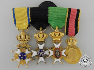 A Fine Miniature Swedish Miniature Group in Gold