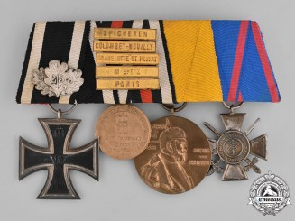 Prussia, State. A Four Piece Medal Bar with an Iron Cross Jubilee Oakleaf and Campaign Bars