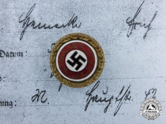 An NSDAP Golden Party Badge; Small Version to Erich Heinecke