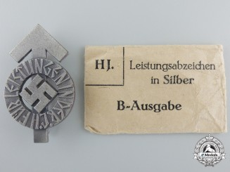 A Hitler Youth Proficiency Badge; Silver Grade with Paper Pocket of Issue