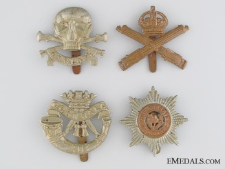 Four WWI & WWII British Cap Badges