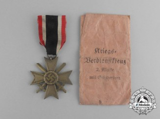 A War Merit Cross Second Class with Swords in its Packet of Issue by E. Schmidhäussler