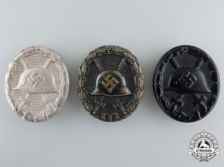 Three German Wound Badges; Carl Wild