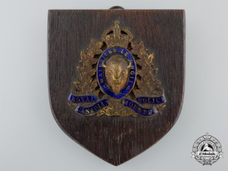 A Royal Canadian Mounted Police (RCMP) Officer's Cap Badge Plaque, c. 1930s