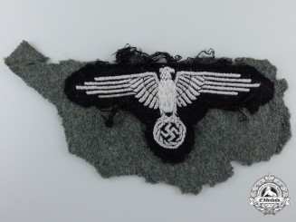 An SS Sleeve Eagle with piece of Uniform
