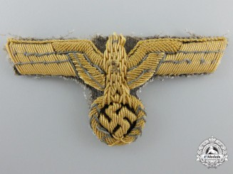 An Army General's Cap Insignia on Tropical Backing
