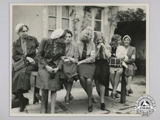 An Official Press Photograph of Seven Captured German Nurses July 1944